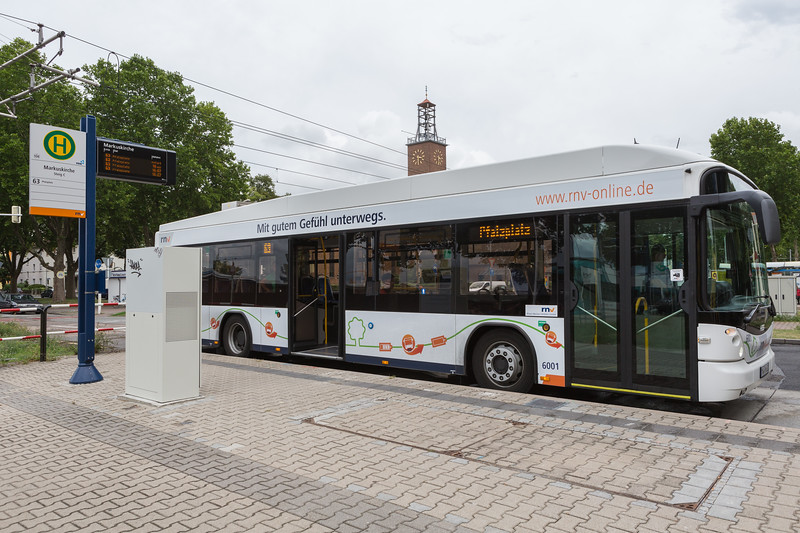 Inductive charging while picking-up and dropping off passengers at bus stop in Mannheim, Germany