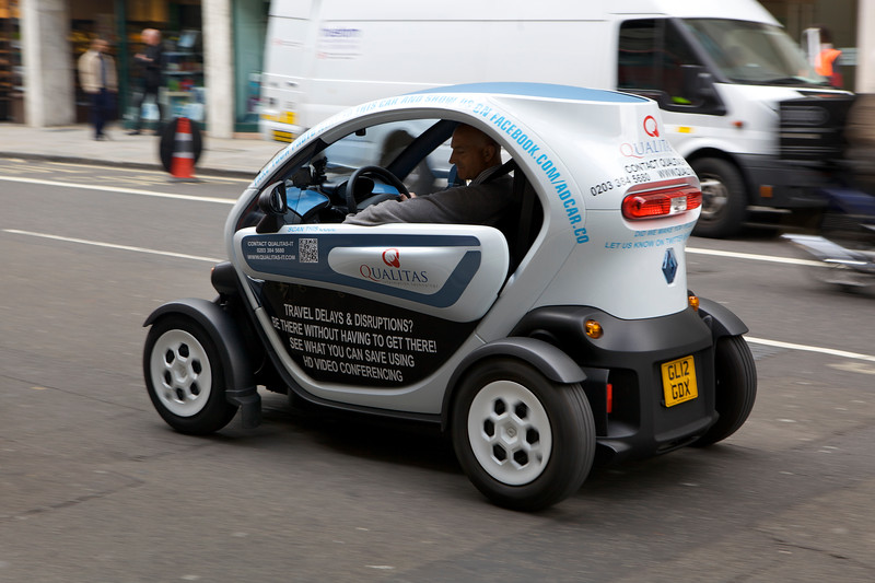 """An electric Renault Twizy driving along the Strand, London on 6 August 2012. <br /> <br /> File No. 060812 8914<br />  ©RLLord<br /> sustainableguernsey@gmail.com<br /> <br /> <a href=""""http://www.sustainableguernsey.info/blog/"""">http://www.sustainableguernsey.info/blog/</a><br /> <br /> ."""