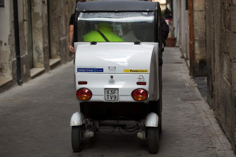 Electric vehicle postal delivery in Siracusa, Sicily, Italy