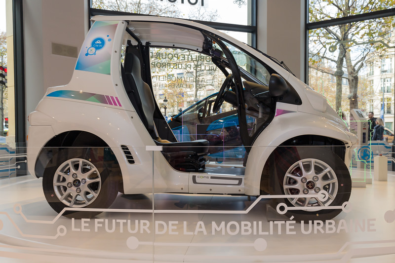 An electric Toyota Coms in the showroom on Champs-Elysées