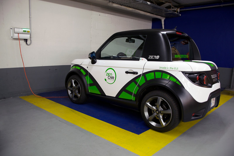 Tazzari electric car charging in Brussels car park
