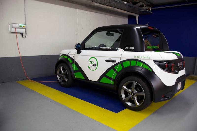 Tazzari electric car charging in Brussels car park