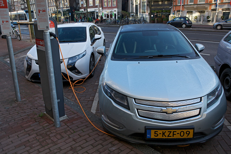 Chevrolet Ampera (left) and Chevrolet Volt (right) being charged at parking bays reserved for electric vehicles in Amsterdam on 5 January 2014<br /> <br /> File No. 050114 7518<br /> <br /> All Rights Reserved ©RLLord<br /> <br /> sustainableguernsey@gmail.com