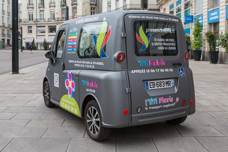 TitiMobile electric vehicle transport service for a passenger in a wheelchair