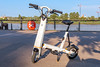 Onemile electric scooter on the quai in Bordeaux, France