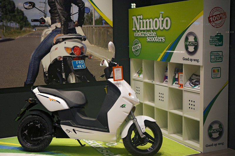 Nimoto electric scooter in shop window, Rotterdam