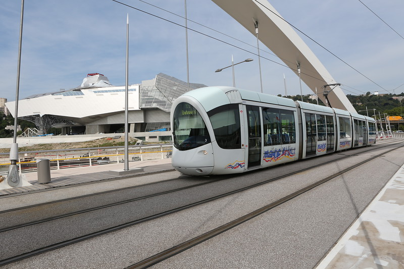 Lyon tram on T1 line crosses Raymond Barre bridge over the Rhône river