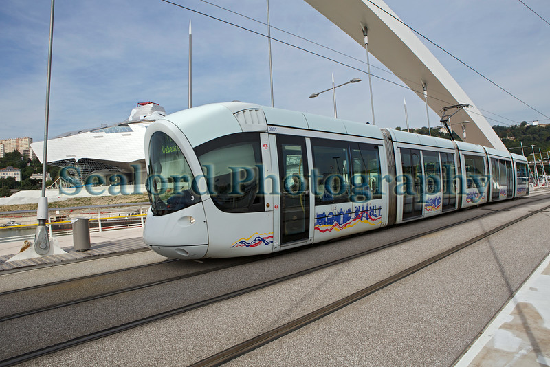 Lyon tram on T1 line crosses Raymond Barre bridge over the Rhône river
