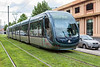 A Transports Bordeaux Metropole electric tram travelling over a carpet of grass in Bordeaux, France