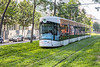 RTM Bombardier Flexity Outlook tram travelling over a carpet of grass on Boulevard de Dunkerque, Marseille, France