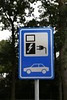 Electric vehicle charging sign in car park in Gennep, Netherlands