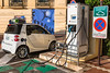 Electric Smart car charging at ABB electric vehicle charging station