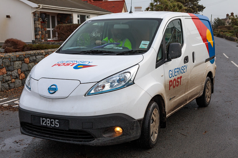 One of Guernsey Post's E-NV200 electric vans making postal deliveries after Storm Eleanor hit the island overnight