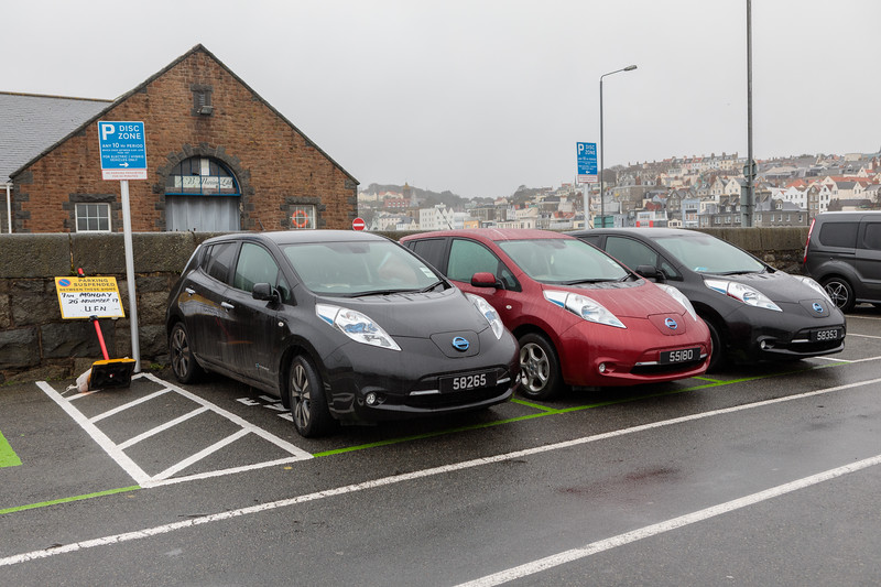 Three Nissan Leaf electric cars parked at North Beach car park, St Peter Port, Guernsey