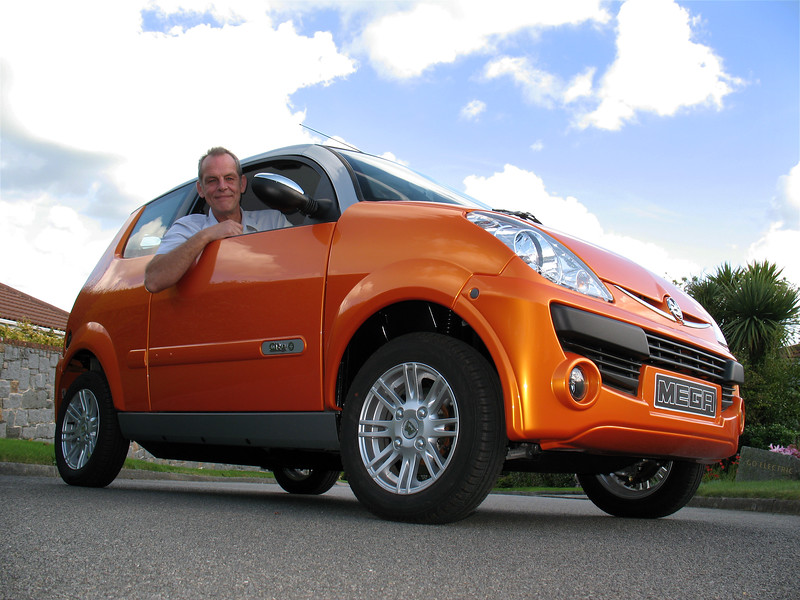 Paul Domaille in his Mega City Electric car in Guernsey in 2008