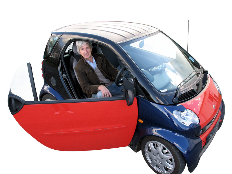 Mark Parr in his electric Smart car converted from petrol in 2007