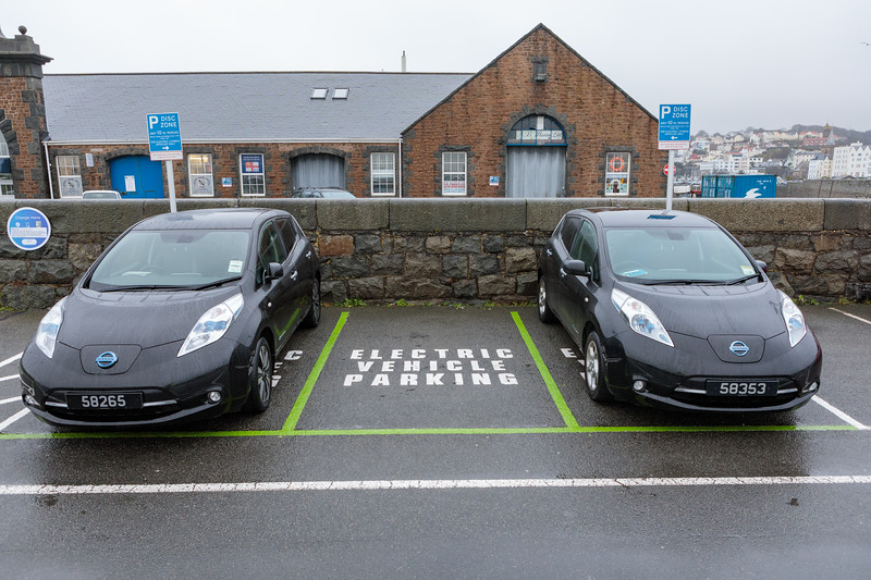 Nissan Leaf electric cars in electric vehicle parking spaces in North Beach car park, St Peter Port, Guernsey
