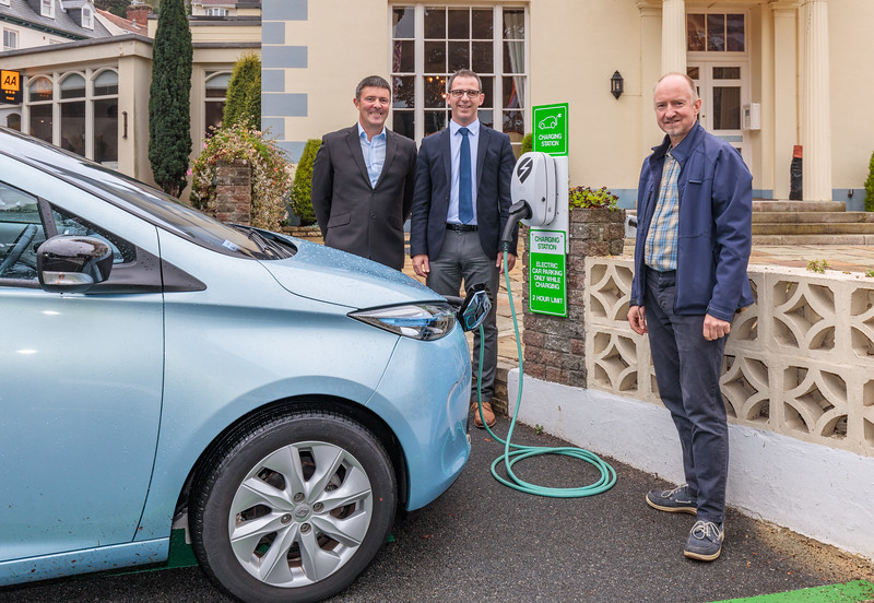 Keith Hounsell, Gennaro Festivo and Sean Fuller by the EO Charge station at Hotel de Havelet, St Peter Port, Guernsey
