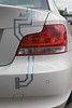 Rear light of electric BMW Active E car at MotorMall in Guernsey