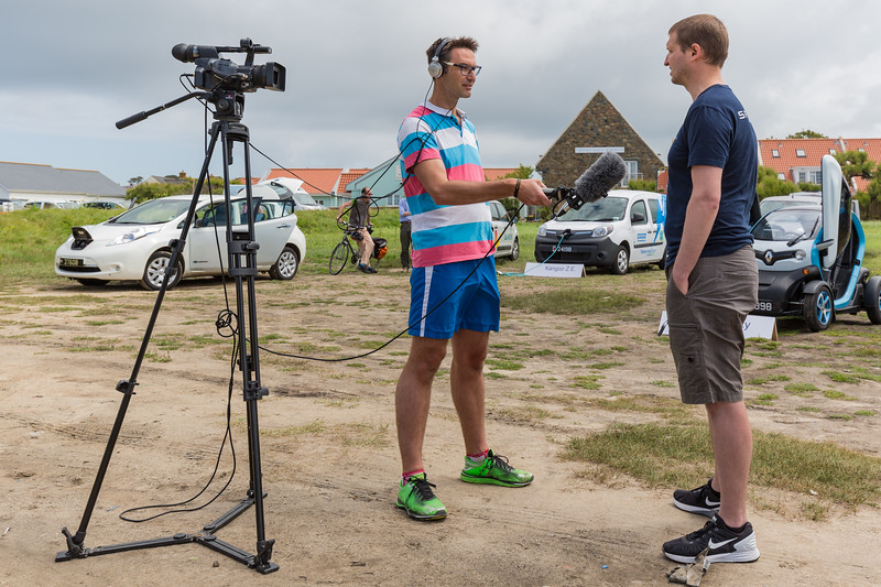 Warren Mauger interviews Zoltan about his Tesla Model S at the Guernsey Electric Vehicle Open Day in June 2016