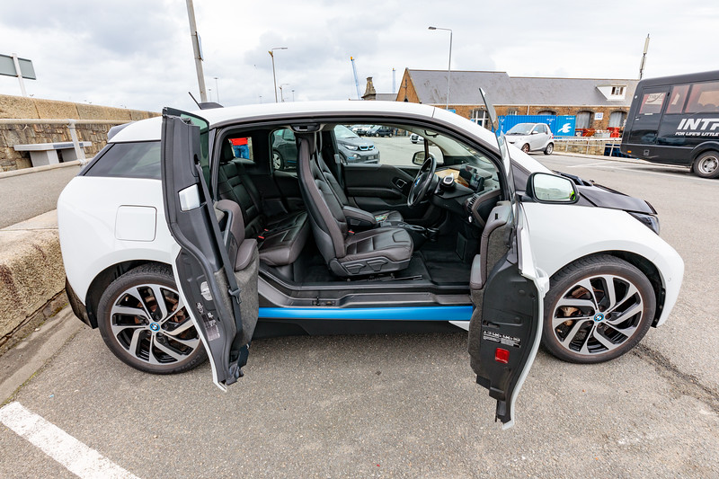 BMW i3 with doors open on St Julian's Pier, St Peter Port, Guernsey