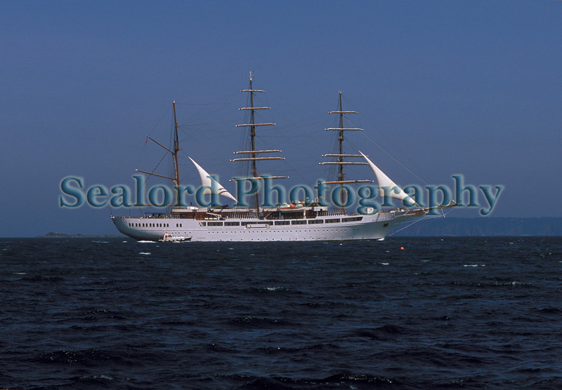 Sea Cloud 2 being escorted by the St Peter Port pilot boat
