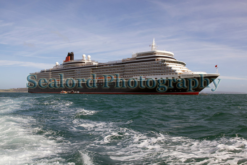 The Cunard cruise ship Queen Elizabeth anchored in the Little Roussel off St Peter Port, Guernsey