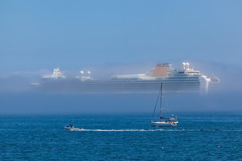 Azura passenger ship shrouded in sea fog in the Little Roussel off St Peter Port, Guernsey