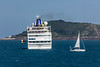 The passenger ship Hamburg lifts up its last tender before departing Guernsey Waters