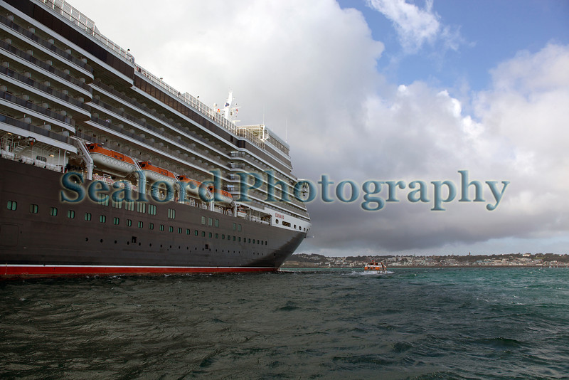 Queen Elizabeth with St Peter Port harbour Guernsey in the background 110911 ©RLLord 0528 smg