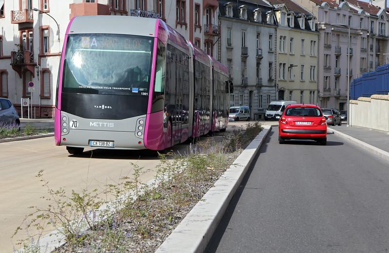 Metz rapid bus service on dedicated lane heading into the city centre
