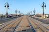 Tram rails and bus and bicycle lanes on Pont de Pierre over the Garonne River in Bordeaux, France