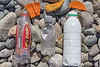 Plastic litter from the pebble and cobble beach south of Fort Pezeries on Guernsey's south west coast on the 16th July 2021