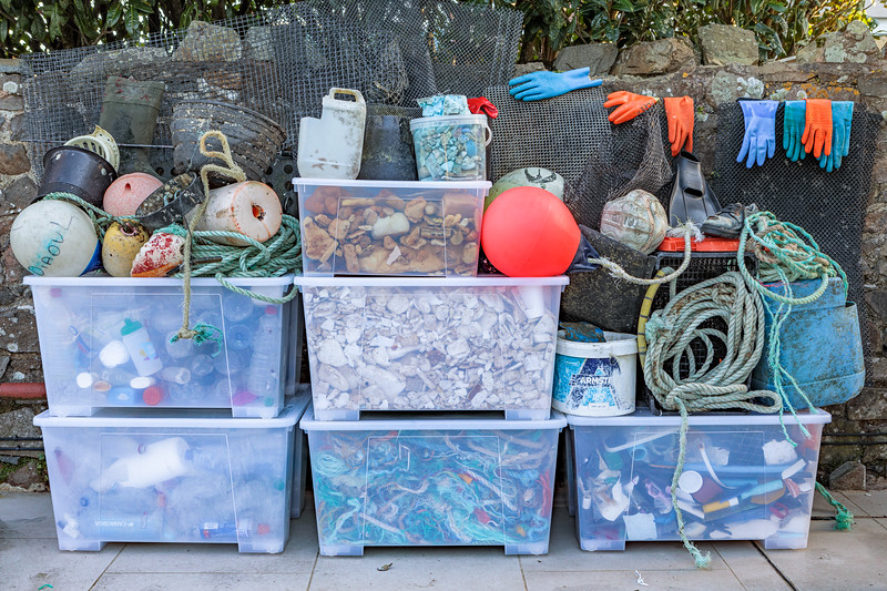 Some sorted and boxed marine litter collected from the Guernsey sea shore