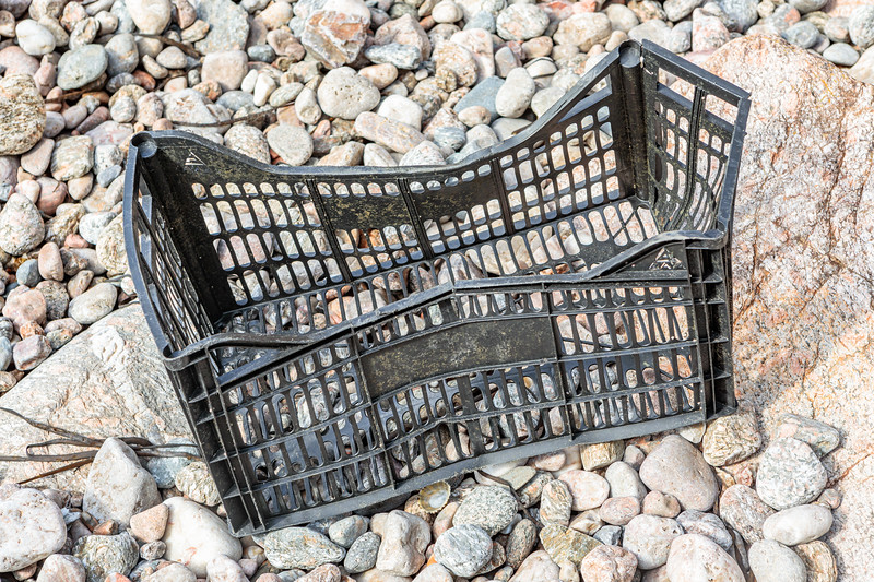 A plastic crate of Spanish origin on the Petit Port sea shore on 3 October 2019