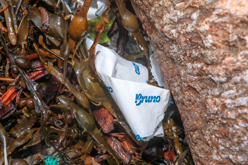 Bruno brand plastic film in the seaweed strand line at Petit Port on Guernsey's south coast on 10th March 2020