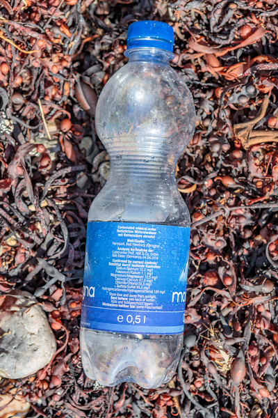 Plastic bottle of Montagna spring water from Bad Harzburg, Germany washed up at Petit Port on Guernsey's south coast
