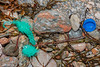 Braided polypropylene twine and plastic bottle screw top at Petit Port on Guernsey's south coast on 15th February 2020