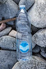 Purity brand plastic water bottle on a cobble shore to the south of Fort Le Marchant on the 22nd September 2021