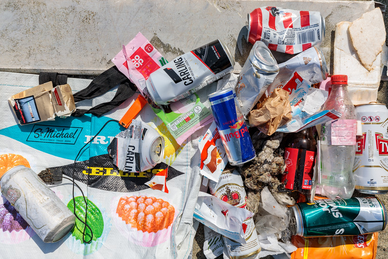 Litter items on a short stretch of the sea shore of Belle Greve Bay on Guernsey's east coast on 6 May 2018