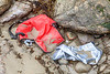 Damaged red Koozie six pack bag cooler washed up at Petit Port on Guernsey's south coast on 8th July 2020