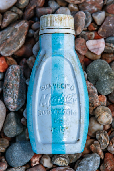 Macier plastic bottle of fabric softener washed up at Petit Port on Guernsey's south coast
