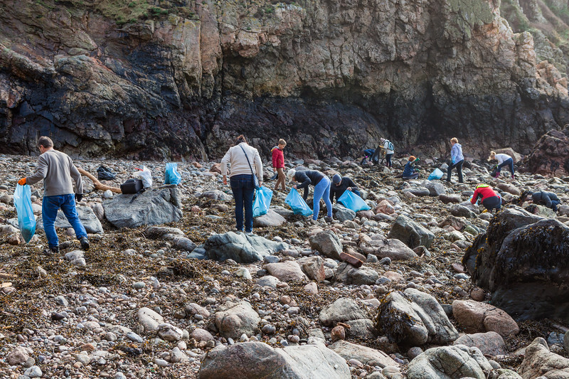 Volunteers picking up sea shore litter at Petit Port on Guernsey's south coast on Sunday 16th February 2014