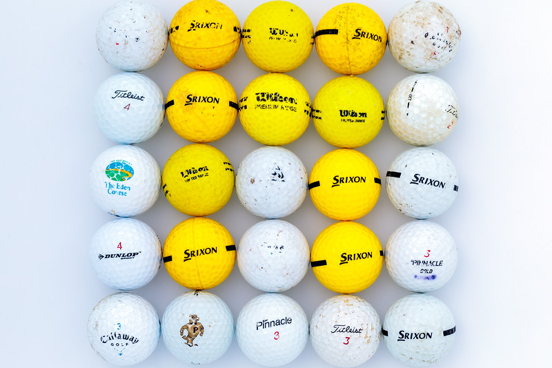 25 golf balls collected from the cobble sea shore at Pleinmont on Guernsey's south coast
