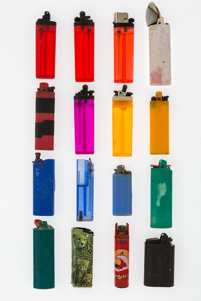 Cigarette lighters collected from the Guernsey sea shore