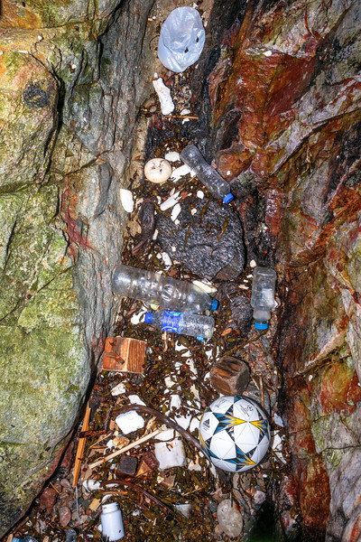 Marine plastic litter washed into a cave in the north east corner of Petit Port on Guernsey's south coast  on 10th March 2020