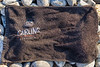 Carling Beer branded hand towel left on a Guernsey north coast beach and photographed on the 22nd September 2021