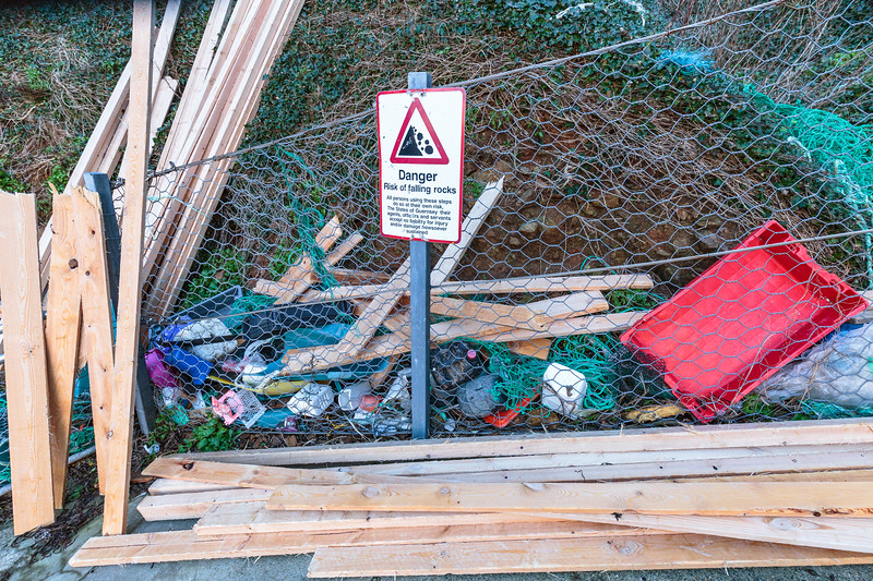 Lumber from MV Koningsborg washed up with other ocean debris at Petit Port on Guernsey's south coast