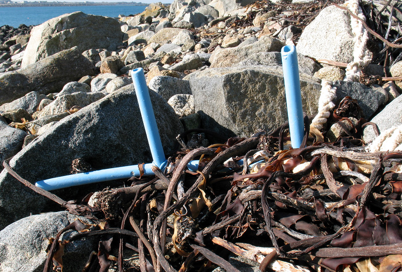 Broken blue plastic tubing lobster and crab pot frame on the sea shore at Champ Rouget on 17th February 2008