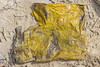 Plastic bag dug out of the sand from the lower shore of Petit Port on Guernsey's south coast on the 28th May 2021